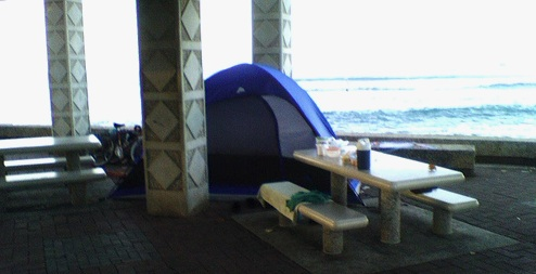 Image of a tent and picnic table.