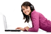 Girl listening to audio book on computer