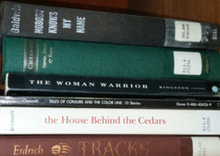 stack of books by Baldwin, Chestnutt, Kingston and Erdrich.