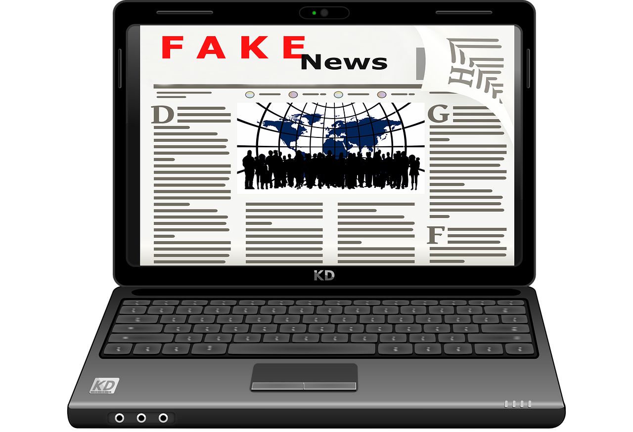 Picture of a computer showing a website that is titled Fake News