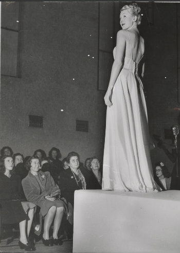Model on podium in evening gown H2002.199/406