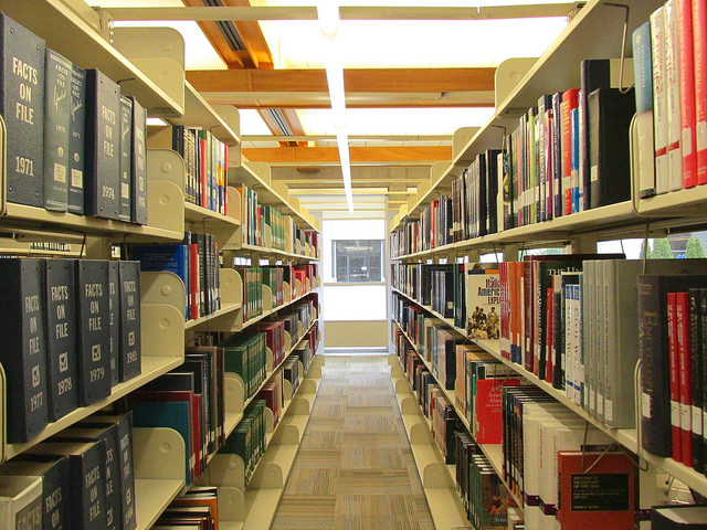 2 rows of bookshelving in the Columbus Campus library