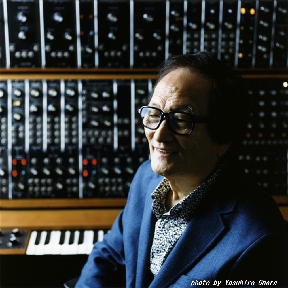 Electronic music composer Isao Tomita, posed with a custom synth array.  Photo by Yasuhiro Ohara.