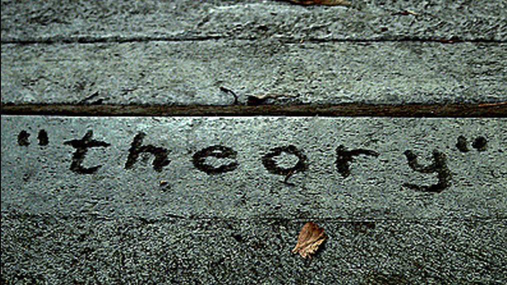 the word 'theory' written on the ground