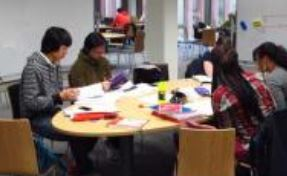 Image of a group of students using the group study rooms available in Maynooth Library