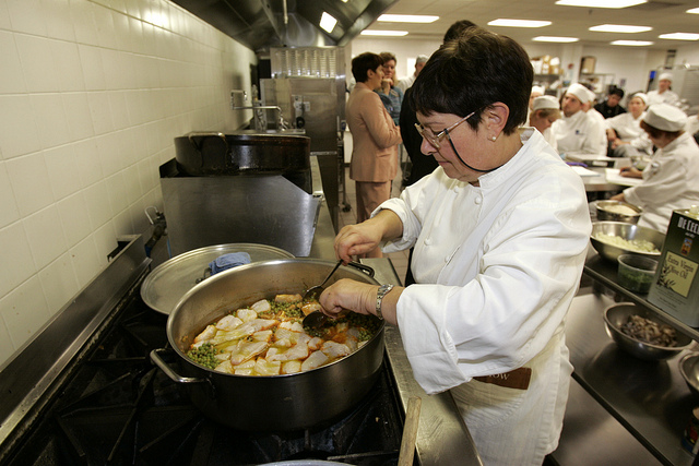 madison college students cooking in kitchen