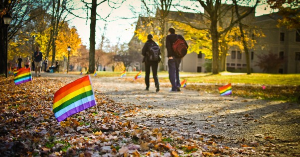 students walking on campus with pride flags