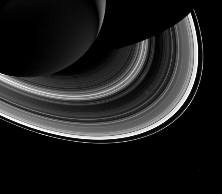 black and white photo of Saturn and its rings