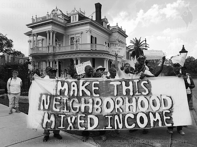 photo of protest banner that reads Make This Neighborhood Mixed Income
