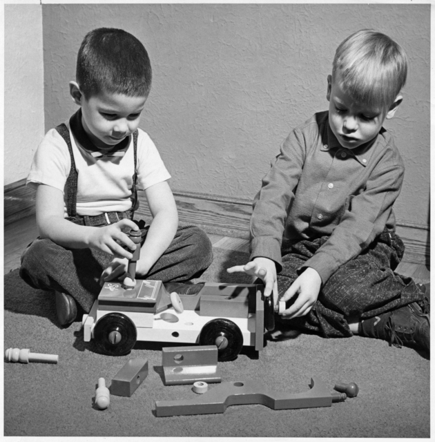 Boys playing with toys manufactured by Sifo Company of St. Paul. approximately 1955.