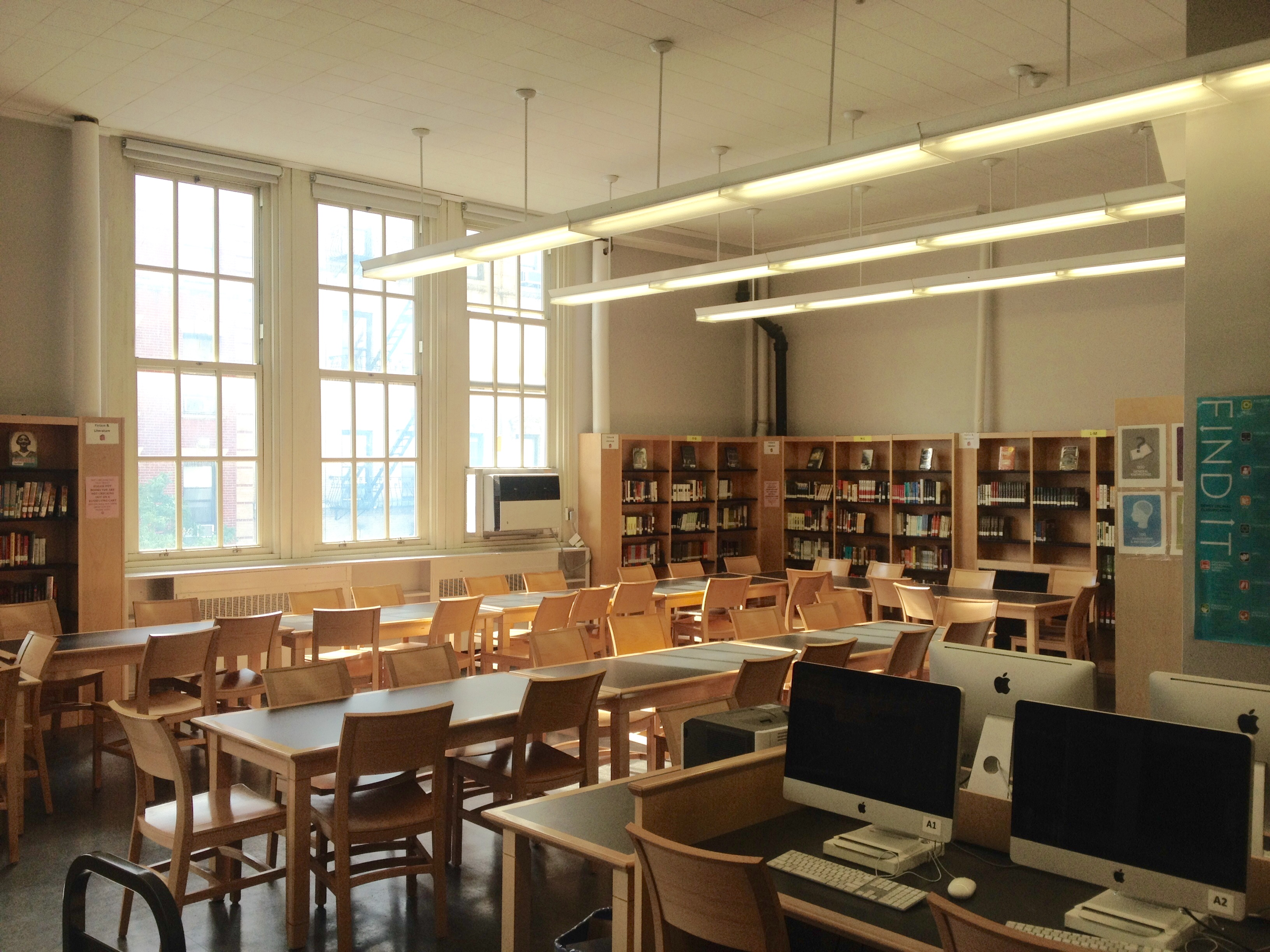 The HPHS Library can seat approximately 50 people and has 12 iMac computers and a printing station.