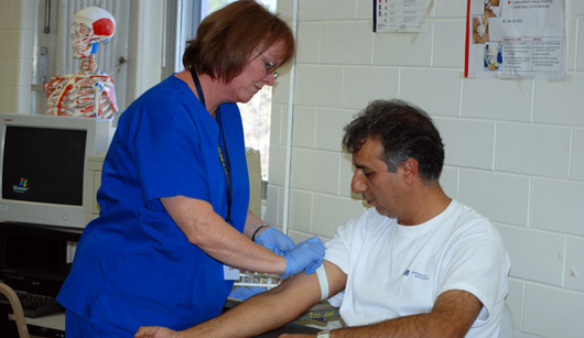 Photo of medical worker with a patient