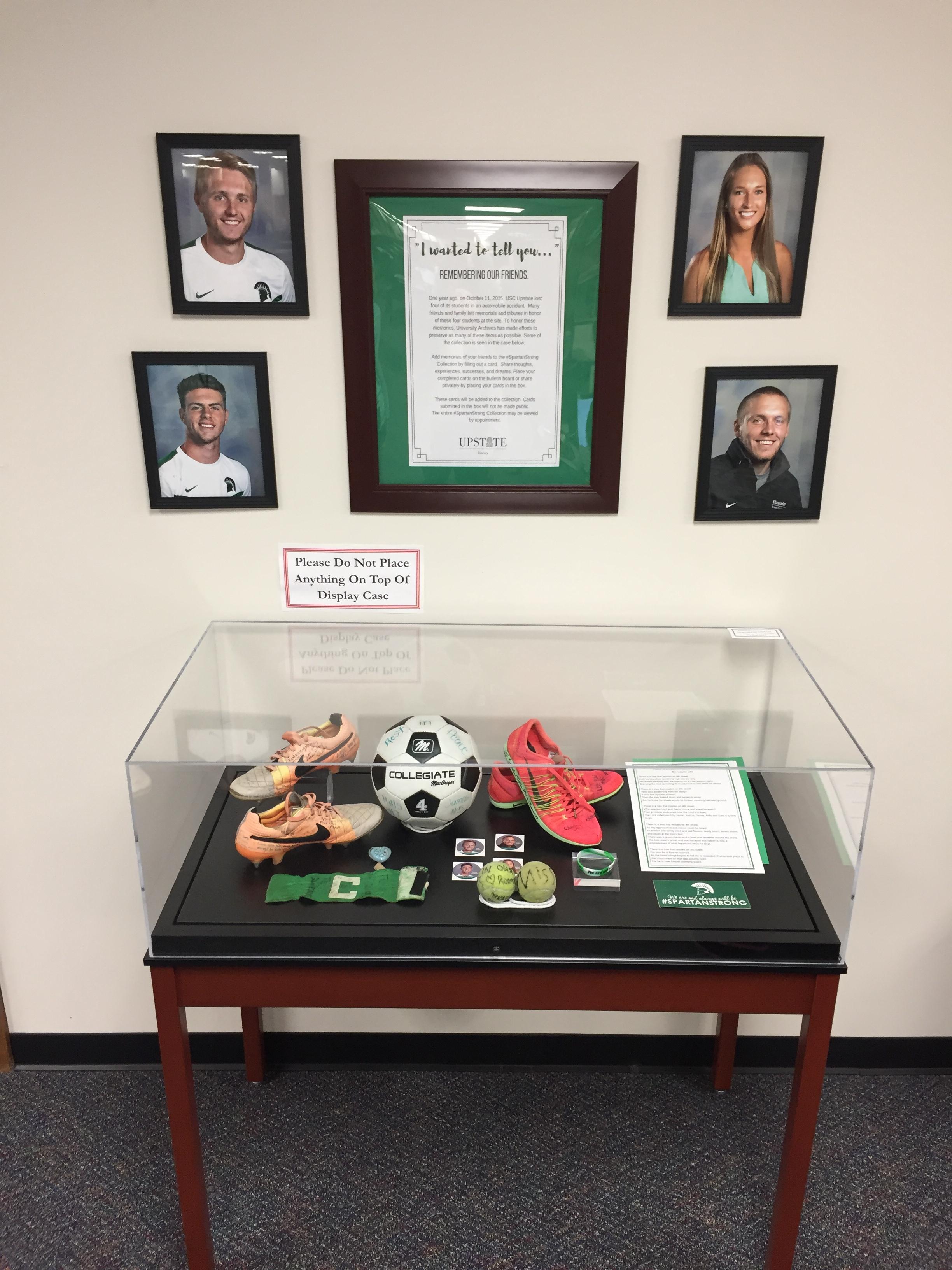 Exhibit case containing memorial items left at accident site.