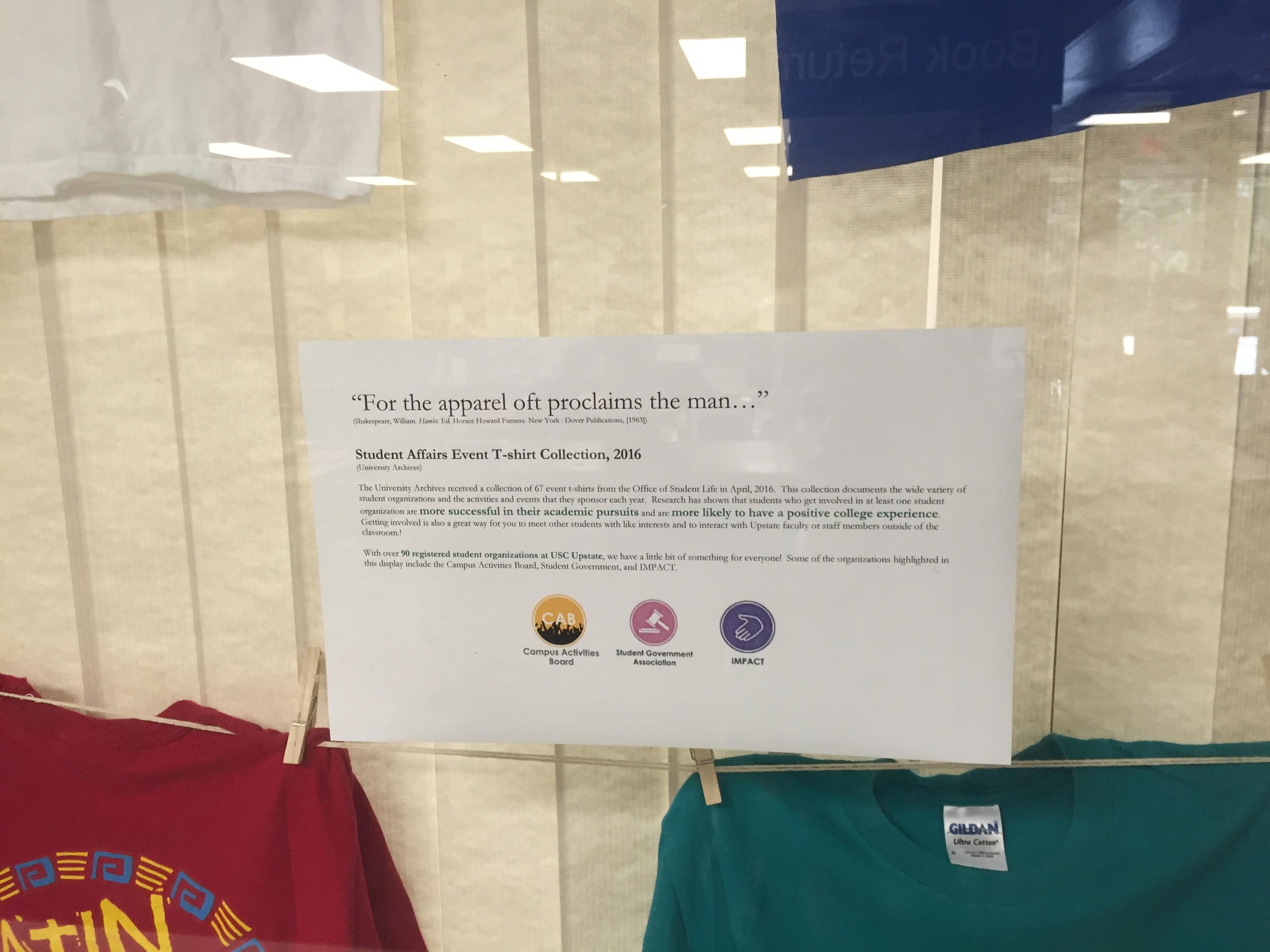 Close up of sign explaining origin of the t-shirt display.