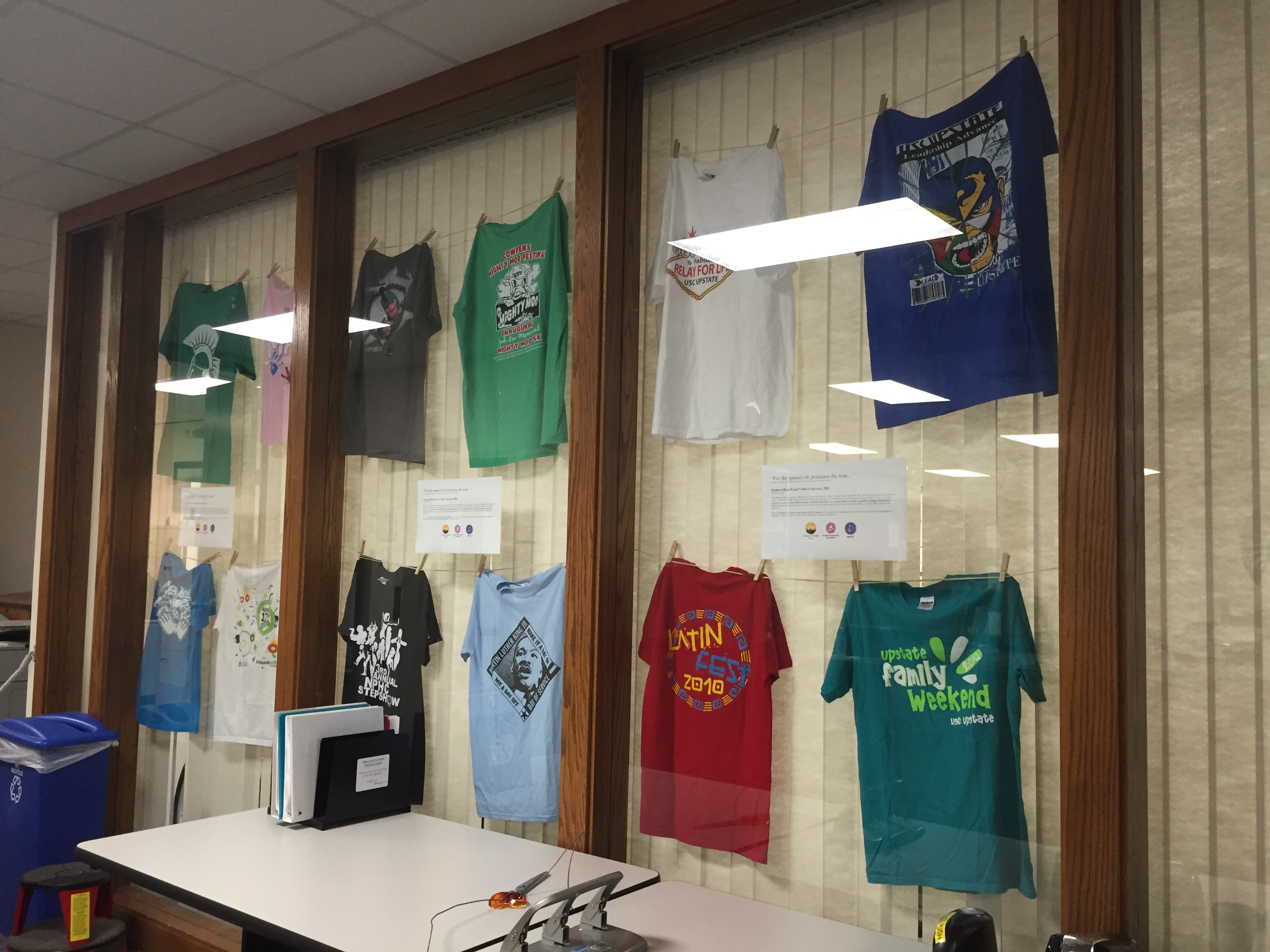 Wide angle view of t-shirts displayed on mock clothesline.