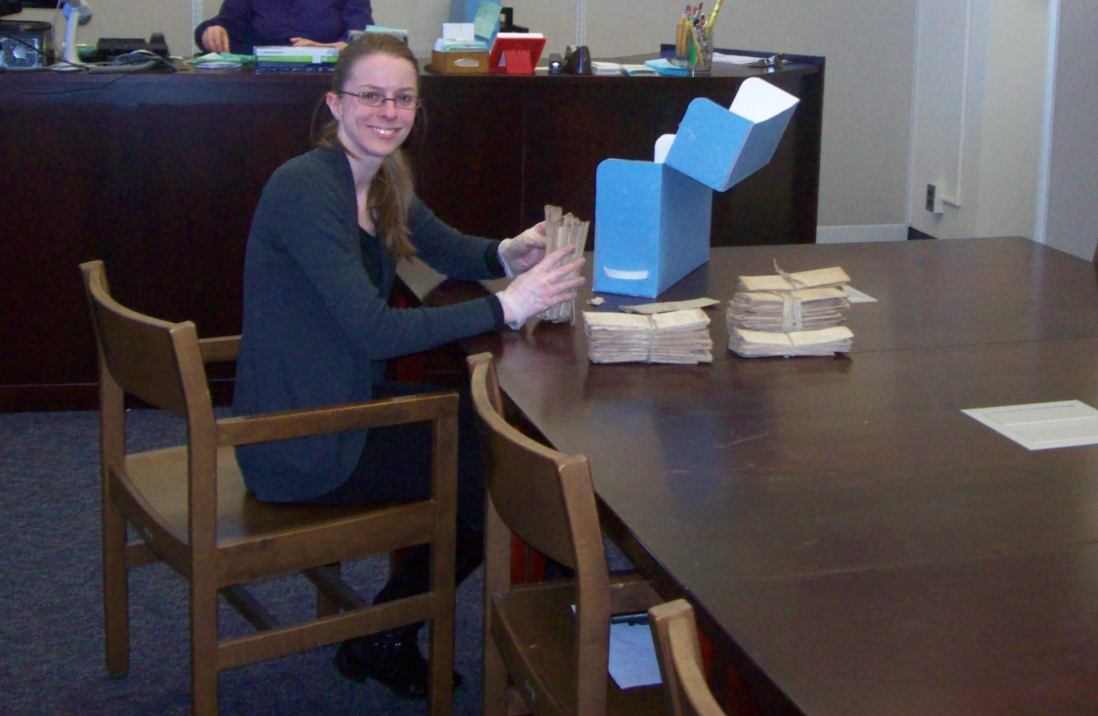 A researcher using archival records