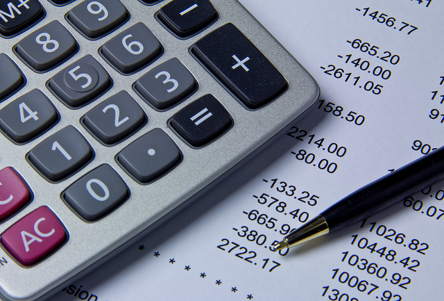 Image of calculator and financial statement