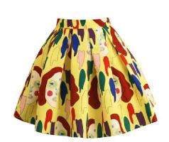 Yellow printed skirt by designer Annakiki. Faces on skirt.