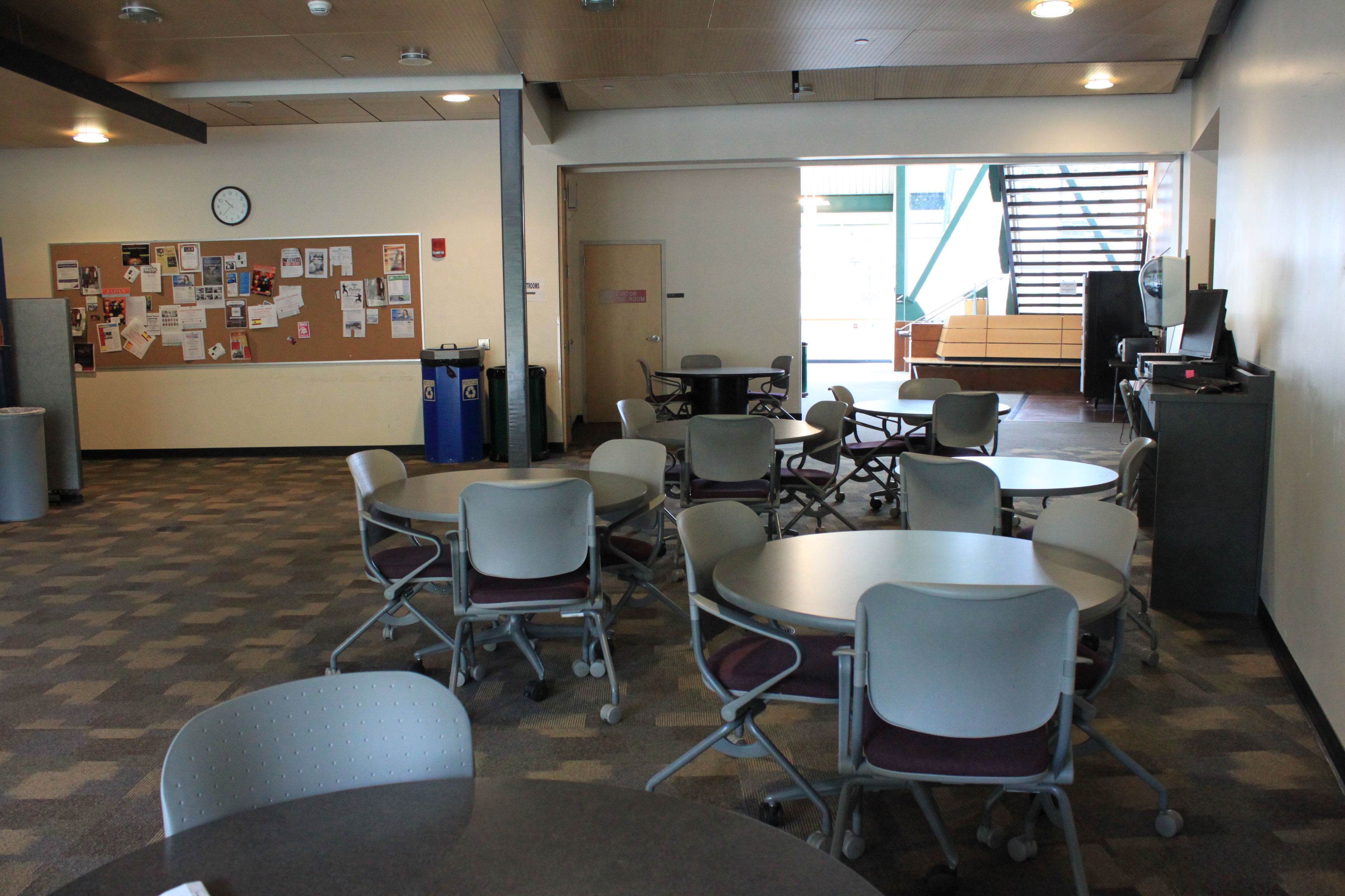 informatal study area - tables and chairs, popular walkway, coffee/snack machines nearby