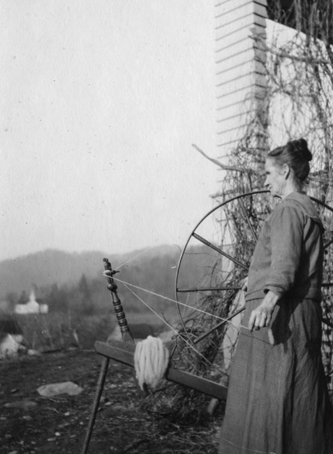 Woman spinning wool.