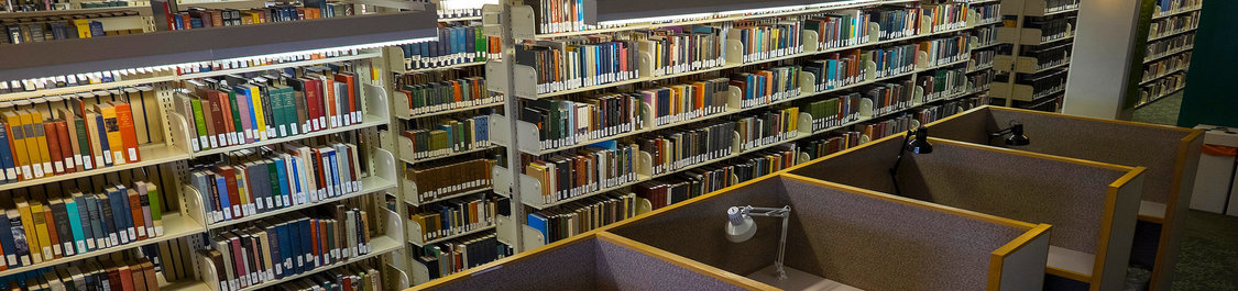 Thousands of books on shelves in Simpson Library