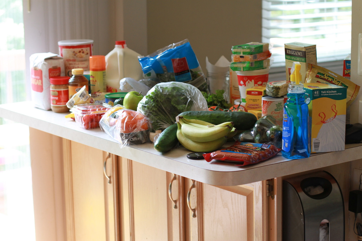 Kitchen counter filled with groceries