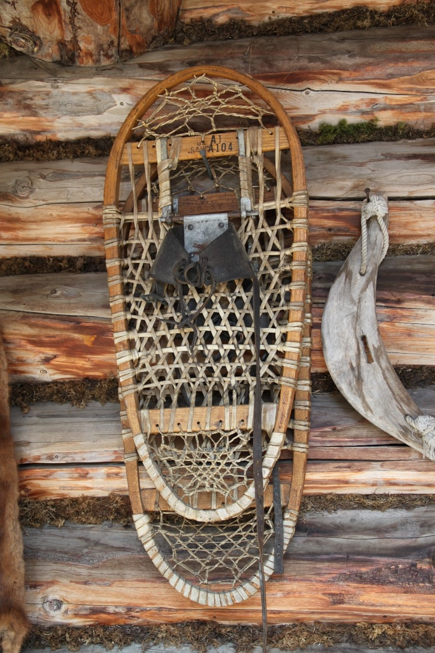 Bear paw snow shoes on the wall of a cabin at Chena Indian Village, Alaska