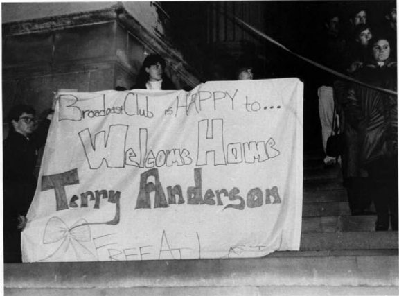 Students holding sign in honor of hostage Terry Anderson.
