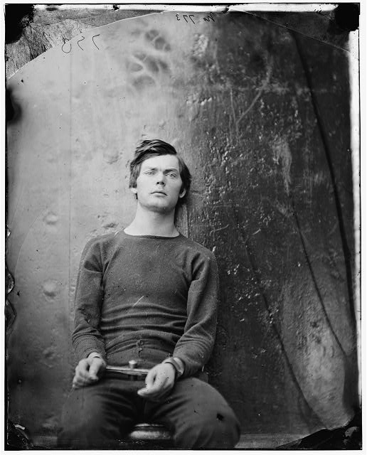 Washington Navy Yard, D.C., co-conspirator Lewis Payne, in sweater, seated and manacled April 1865, photograph by Alexander Gardner (1821-1882)