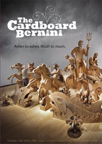 A DVD cover with a photo of sculptures made from cardboard. The title text is white.