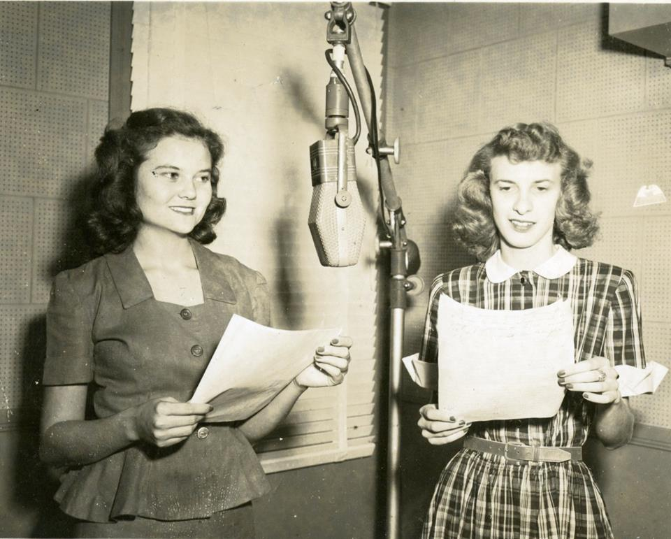 Archive shots of women at the radio station