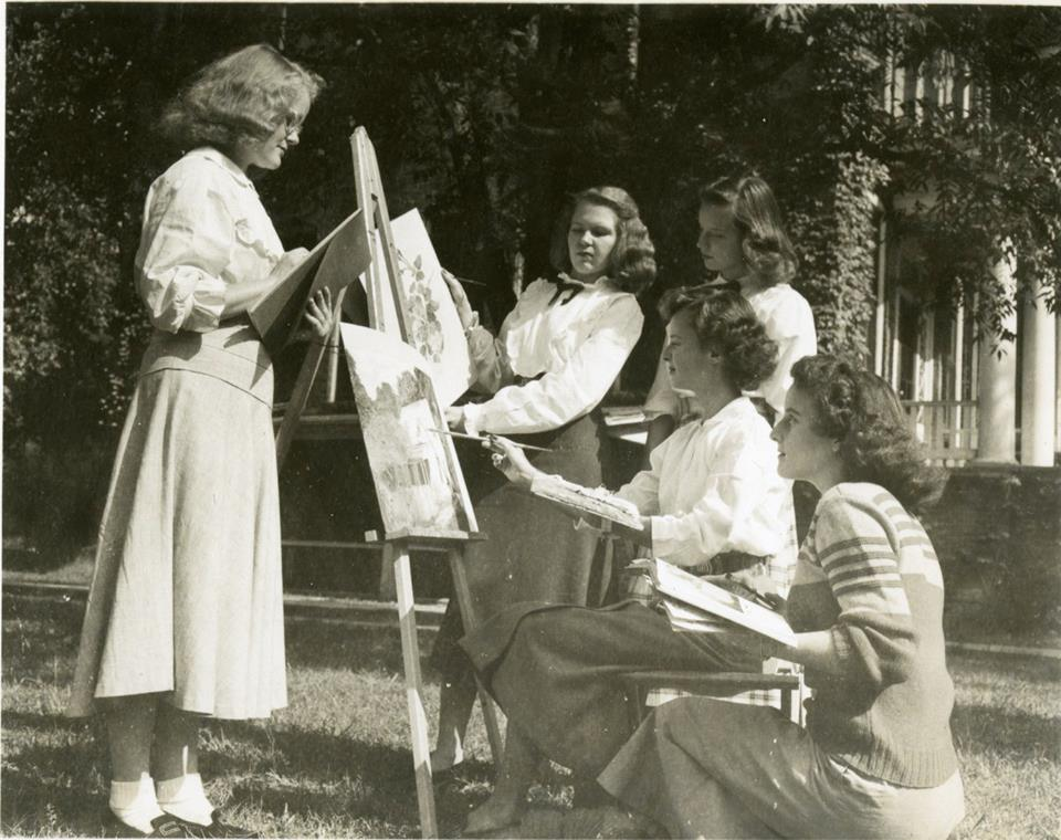 Archive shot of female students painting outside