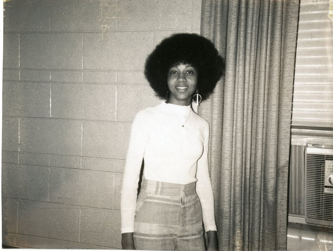 Archive shot of female student inside dorm in the 1970s