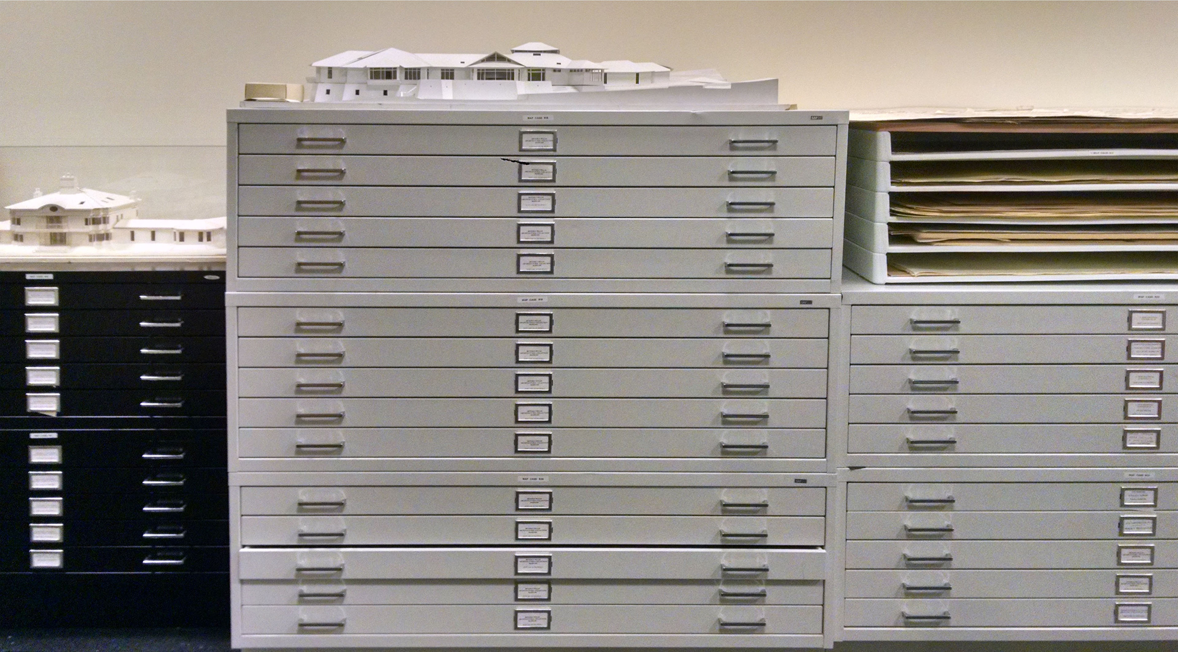 Three ranges of map cases for storing flat architectural drawings. Two architectural models are stored on top