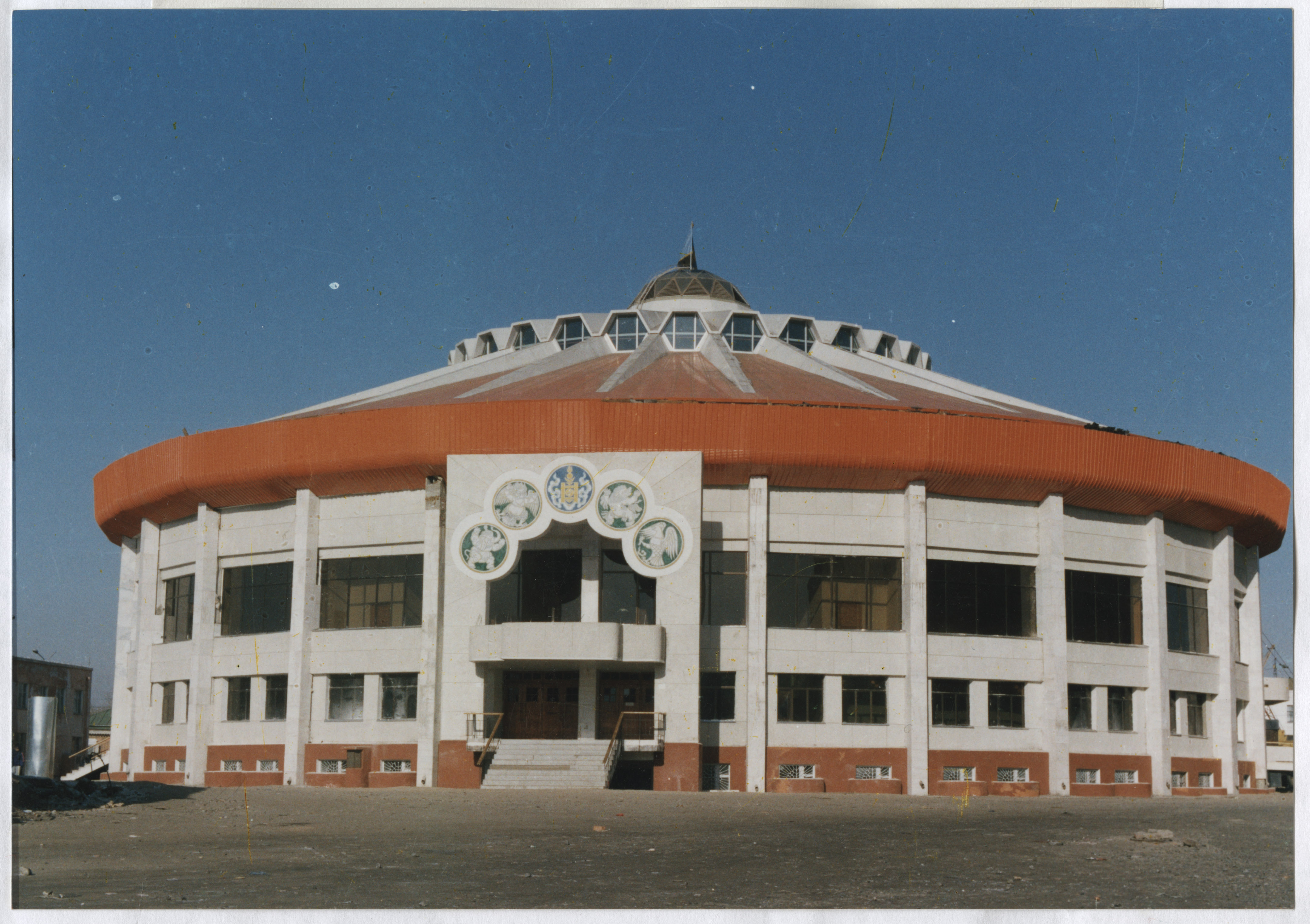 Color photograph of National Wrestling Palace in Ulaan-Baatar in Mongolia. Front view.