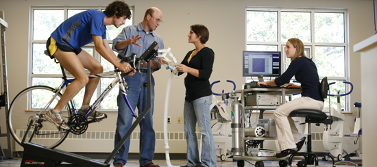 Bicyclist, instructor, & students in USM's physiology lab.