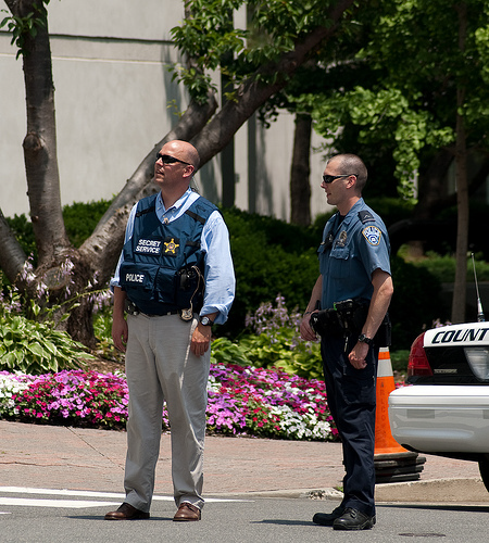 Secret service agent with local police at a scene