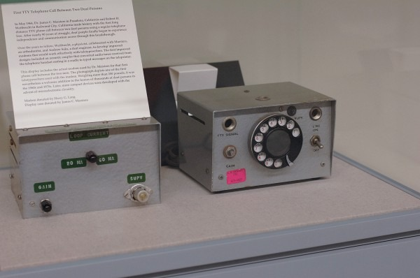The picture to the left shows the first TTY modem invented by Robert H. Weitbrecht in 1964 and can be viewed at RADSCC, Wallace Center.