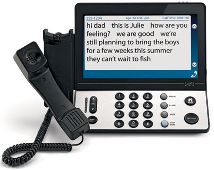 The image shows a phone with a screen for captions and the dial keyboard