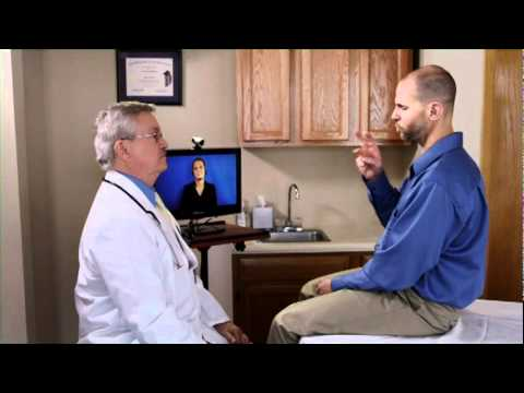 The image shows a doctor conferring with a deaf patient (man) and a remote interpreter on a tv screen.