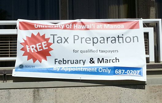 Banner advertising VITA tax preparation services at UHM