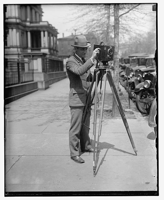Man using a Motion Picture Camera on a Tripod
