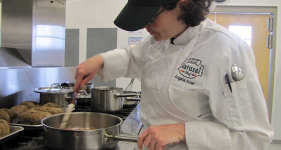 Picture of a chef stirring something in a pot