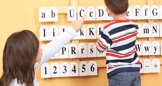 Picture of a child learning his alphabet