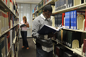 Photograph of students looking through books