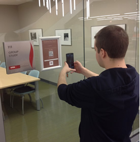 person using QR Reader