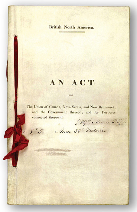 An old document in a booklet, held together by red ribbon. The text reads,