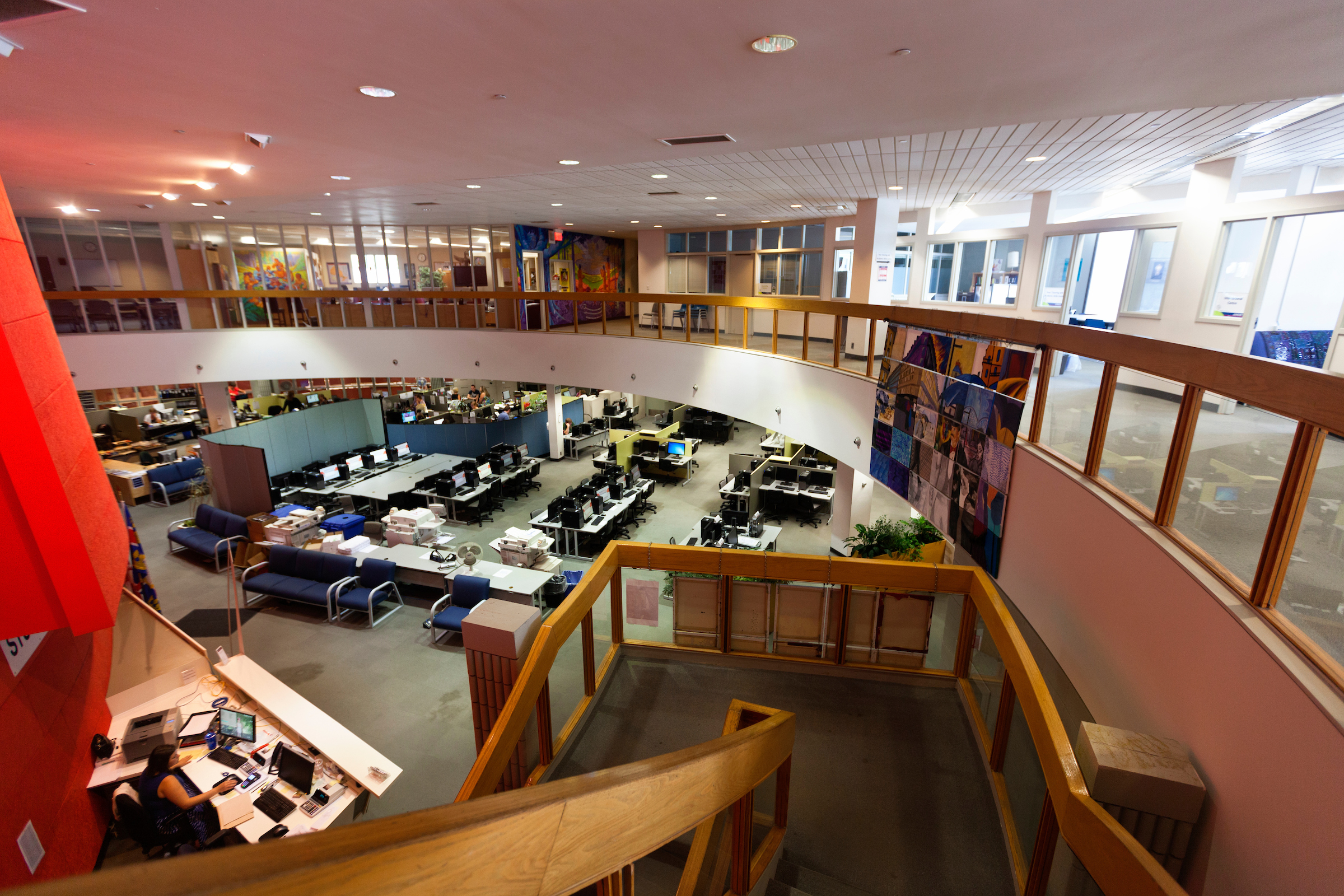 An overhead view of a large computer lab. The offices on the floor above the lab can also be seen.