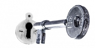Silver Key Going Into Lock