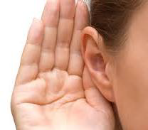Hand cupped over an ear
